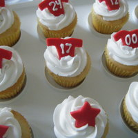 Jersey Cupcakes Each player had their own number on each little jersey. Jerseys are fondant. Icing is buttercream.