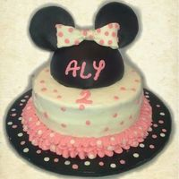 Minnie Mouse Cake Buttercream with fondant and gum paste accents. Confetti sprinkles