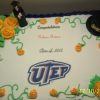 Utep Grad buttercream,roses,sheet cake with edible image,grad. figurine and cap.