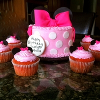 Minnie Mouse Smash Cake With Cupcakes Cake was pink lemonade with vanilla buttercream.