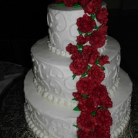 My Brother's Wedding Cake This was my first stacked cake (SPS). It is a three tier round french vanilla with raspberry filling. It's frosted with buttecream and...