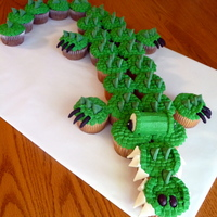 Cupcake Croc As seen in Hello Cupcake book. My kids school mascot is a crocodile! Eyes and teeth used marshmallows. Scales used green Wilton candy melts...
