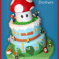 Super Mario Brothers Super Mario Brothers cake with toy figurines.