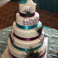 Peacock Wedding Cake Peacocks On Top Are Handmade Out Of Fondant Peacock wedding cake. Peacocks on top are handmade out of fondant.