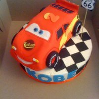 Cars Lightning Mcqueen L McQueen cake made from Wilton car cake pan, carved a little, fondant deco.