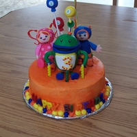 Umizoomi Birthday Cake Made this for my 3 year old who is into Umizoomi. Characters out of RKT and fondant. Had so many issues with how heavy their big heads were...