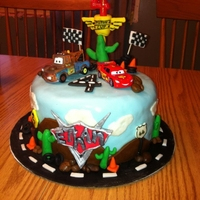 Cars Birthday Cake  Cars cake I did for my son's 4th Birthday. Everything is fondant except Lightning McQueen and Mater. Got inspiration from all the...