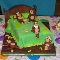 Five Little Monkeys This was my son's first birthday cake. The bed is white almond sour cream covered in fondant. The monkeys are a 50/50 mix of gumpaste...