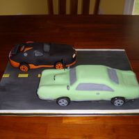 Cars These two cakes were for a man and his grandson. The green car is supposed to be a 66 GTO, and the black car is a Bugatti. Thanks for...