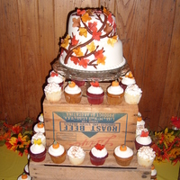 Chad And Diana's Wedding Cupcake tower with small cake for my brother-in-law's rustic wedding.
