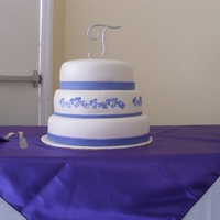 Purple And White This is a purple and white wedding cake. 2nd wedding cake i've ever done. Its a white cake with a strawberry filling butter cream...