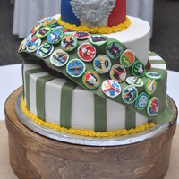 Eagle Scout Cake white, Strawberry and chocolate cake with buttercream frosting. Fondant sash and badges are royal icing.