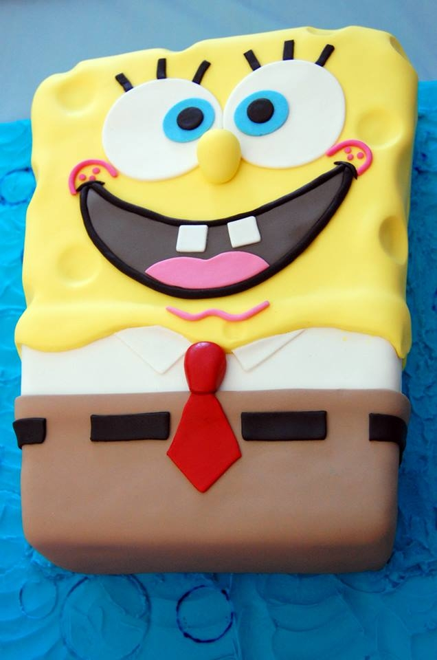 Spongebob Squarepants Carved white cake with lemon curd filling, ganached and fondant.
