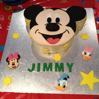 Mickey Mouse Mickey and friends cake for my sons 2nd birthday. Unfortunately I was running very late and didnt get time to cover the cake board :(...