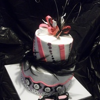 Pink/black Buttercream cake and fondant accents. High heel shoe, bow and butterfly is 50/50 paste. TFL