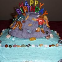 Rock Climbing Adventure I had fun making this cake. The climbing wall was made from rice crispie treats and covered with fondant.