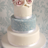 Wedgewood Cake A delicate-coloured three tier cake. Middle tier is brush embroidered and piped. Small white piping around edge of top and bottom tier and...