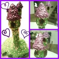 Rapunzel's Tower Cake   Chocolate cake at the bottom, the whole tower is Rice Krispy Treats covered in fondant. SOOO much fun! Thanks for looking!