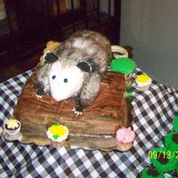 Possum Cake For George Jones This was for George Jone's 80th birthday party. The log is white cake with fondant and the possum is chocolate cake .