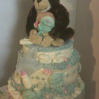 Monkey/diaper Cake I made this today for my dd's shower tomorrow. It took 2 batches of mmf. white cake on the top two layers and chocolate on the bottom...