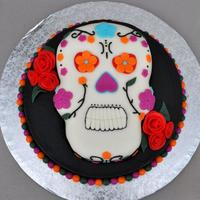 Day Of The Dead Day of the Dead Cake- Skull is carved out of RKT. Everything is Fondant with a buttercream cake