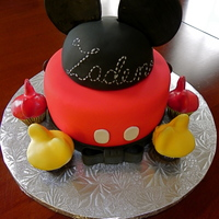 Mickey Cake And Mini Cuppies Cake done for a baby shower - their nursery theme is Mickey!Thought about doing Mickey silhouette cake pops, but have been doing so many...