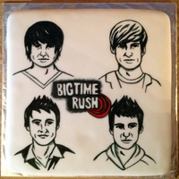 Big Time Rush 12 inch half White and half Chocolate cake with Buttercream icing and covered with fondant. Design handpainted with gel colors.