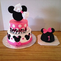 Minnie Mouse & Mouse Ears Smash Cake  Minnie Mouse Cake: White cake with 6 & 8 inch tiers with Vanilla icing. Decorations are fondant. Topper handcut from foamboard with a...