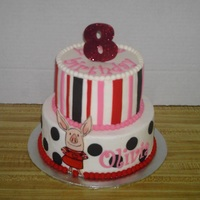 Olivia The Pig Two tier Strawberry cake with 6 & 8 inch tiers covered with Buttercream icing. Fondant decorations. Handpainted fondant Olivia the Pig...