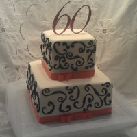 Kerry's Cake   White fondant finish, piped black scrolls, madagascan vanilla bean with strawberry filling.