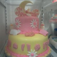 Pink & Yellow Baby Shower French Vanilla Cake with Creamcheese frosting. Covered in MMF and all decorations are chocolate exceptbaby and flower those were also MMF...