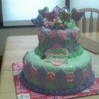 Tinker Bell Cake Covered in MMF and hand made chocolate decorations