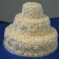 Ivory Rosette Wedding Cake This was a cake a friend and I did at the last minute for a friend of a co-worker...the person supplying her cake for her wedding bailed on...