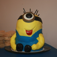 "Despicable Me Minion Cake My very first attempt at more than just a ""basic"" cake...first stacked cake, first character cake, first time with fondant. I..."