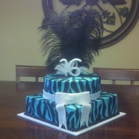 Sweet Sixteen Cake 12 and 10 inch cakes. Stripes, bow, and numbers are fondant.