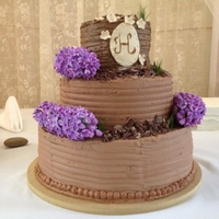 Lilac And Wheatgrass Wedding Cake This is my first wedding cake. 2 tiers of chocolate cake with chocolate icing. 1 tier of white almond sourcream cake with chocolate icing....