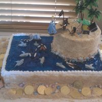 Pirate Birthday Cake Bottom is chocolate with fudge filling, island is WASC with Bavarian Cream filling. Used Sugar Shack's icing and Nilla Wafers for the...