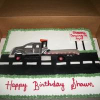 Tow Truck Birthday Cake Yellow sheet cake. with buttercream icing. The tow truck was made out of fondant.