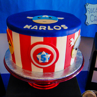 Avengers 5Th Birthday 8 inch fondant Avengers themed birthday cake with characters around the sides of cake.