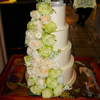 Simple Wedding Cake Super simple buttercream cake with fresh flower cascade. The bride wanted a ton of flowers...i feel like it's too much, but overall, I...