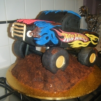 Monster Truck Chocolate mud cake, fondant and rice crispy tyres.