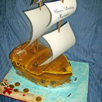 Pirate Cake Pirate ship cake. Dowel masts and paper sails...X marks the spot on the board with sharks swimming nearby.