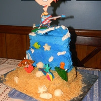 Backyard Beach Phineas And Ferb my sons 7th birthday- he wanted a giant wave cake... all butter cream, marble cake, white choc candy shells, plastic cupcake picks and air...