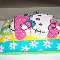Hello Kitty Hello kitty created for a 5 yr old girls birthday party. Did not have cake pan so i did the bottom layer a 2 inchX 13 X 9 sheet cake....