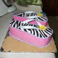 Flip Flops Made this cake for my sisters 30th birthday- she is obsessed with shoes and flip flops. wilton sugar sheet, pink/purple butter cream...