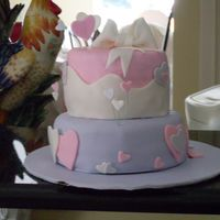 4Th Birthday One of my first tiered cakes (did it over the summer, just uploaded)...it was a bit lumpy oops! TFL