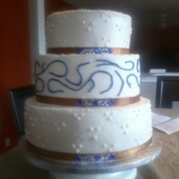 Wedding Cake 12 in, 10in, & 8in..buttercream icing w/fabric ribbion and gemstones (found at arts & craft store for &1.00, it really brought...
