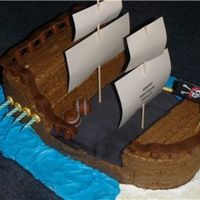 Pirate Ship Made this for my grandson's 8th b'day. All buttercream with fondant accents. He loved the cake. My first 3d cake
