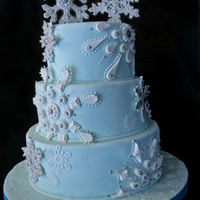 Snowflake Themed Wedding Cake A Snowflake Themed Cake for a very good friend's winter wonderland themed wedding. I chose a very pale aqua color for the cake....