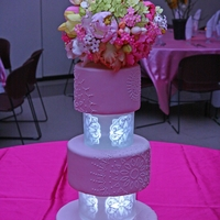 Pale Pink Cake With Self Illuminated Tiers Separators This is actually my daughter's baptism cake but I made it to look like a wedding cake. The topper had gumpaste peonies, parrot tulips...